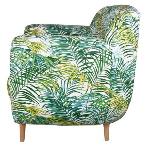 Sofá estilo nórdico con aire tropical